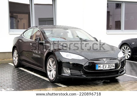 BERLIN, GERMANY - AUGUST 15, 2014: American electric sedan Tesla Model S at the city street. - stock photo
