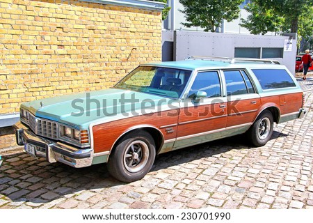 BERLIN, GERMANY - AUGUST 12, 2014: American full-size station wagon Pontiac Grand Safari in the museum of vintage cars Classic Remise. - stock photo