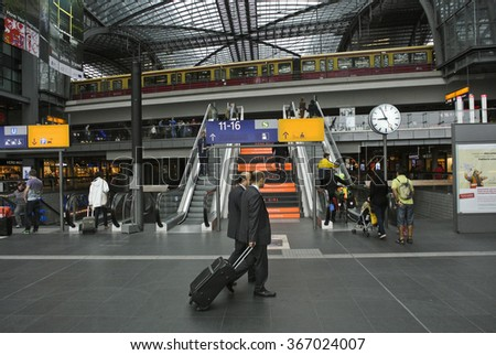 BERLIN, GERMANY - AUGUST 25, 2013: Berlin Hauptbahnhof, the main railway station in Berlin, welcomes an estimated 350,000 passengers traveling on 1,800 trains each day, Berlin, Germany, Aug.25, 2013.