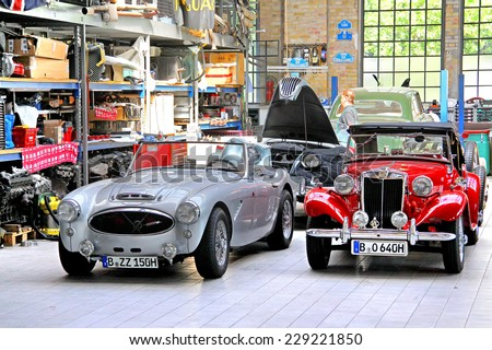 BERLIN, GERMANY - AUGUST 12, 2014: British classic cars Austin-Healey 3000 and MG T-Type in the museum of vintage cars Classic Remise. - stock photo