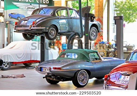 BERLIN, GERMANY - AUGUST 12, 2014: British classic cars Jaguar in the workshop of the museum of vintage cars Classic Remise. - stock photo