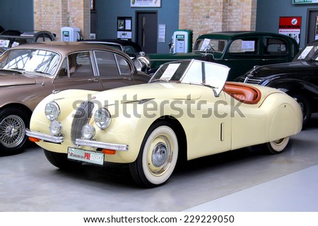 BERLIN, GERMANY - AUGUST 12, 2014: British classic vehicle Jaguar XK150 in the museum of vintage cars Classic Remise. - stock photo