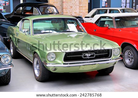 BERLIN, GERMANY - AUGUST 12, 2014: Classic american muscle car Ford Mustang in the museum of vintage cars Classic Remise. - stock photo