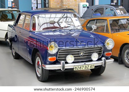 BERLIN, GERMANY - AUGUST 12, 2014: French retro car Peugeot 404 in the museum of vintage cars Classic Remise. - stock photo