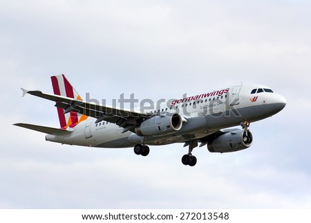 BERLIN, GERMANY - AUGUST 17, 2014: Germanwings Airbus A319 arrives to the Tegel International Airport. - stock photo