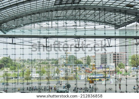 BERLIN, GERMANY- AUGUST 10, 2013: Glass  facade of the city  main railway station . The Hauptbahnhof is the largest train  station in Europe. - stock photo