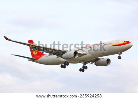 BERLIN, GERMANY - AUGUST 17, 2014: Hainan Airlines Airbus A330 arrives to the Tegel International Airport. - stock photo