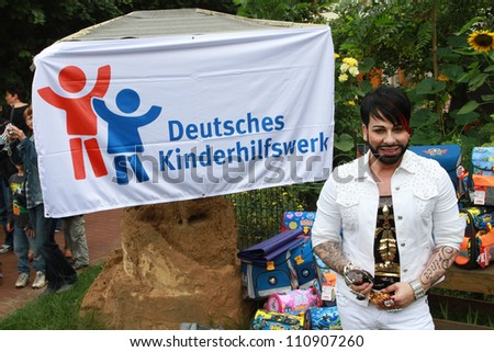 BERLIN, GERMANY - AUGUST 08: Harald Gloeoeckler donates satchels to first Graders at a nursery school at Friedrichshain on August 8, 2012 in Berlin, Germany.
