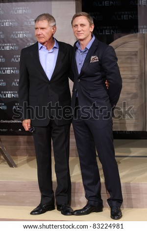 BERLIN, GERMANY - AUGUST 08: Harrison Ford and Daniel Craig attend the 'Cowboys and Aliens' premiere in Cinestar on August 8, 2011 in Berlin, Germany.
