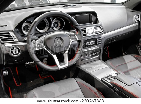 BERLIN, GERMANY - AUGUST 16, 2014: Interior of the brand new car Mercedes-Benz C207 E-class in the Mercedes-Benz showroom. - stock photo