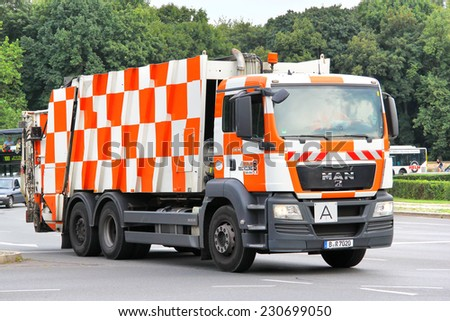 BERLIN, GERMANY - AUGUST 15, 2014: Modern garbage truck MAN TGS 28.320 at the city street. - stock photo