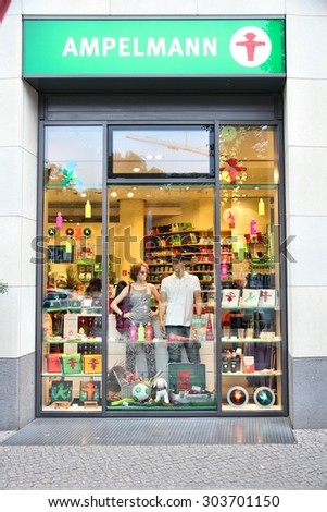 BERLIN, GERMANY - AUGUST 25, 2014: People visit Ampelmann souvenir store in Berlin. Ampelmann is the pedestrian light symbol in Berlin. It was conceived in 1961. - stock photo