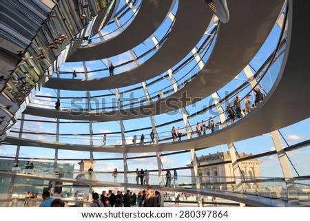 BERLIN, GERMANY - AUGUST 27, 2014: People visit Reichstag building dome in Berlin. The dome was completed in 1999. It was designed by architect Norman Foster. - stock photo