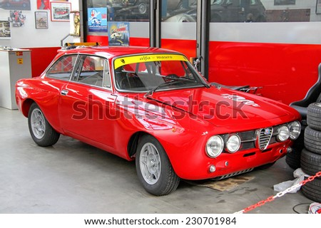 BERLIN, GERMANY - AUGUST 12, 2014: Red italian sports car Alfa Romeo 1750 GT Veloce in the museum of vintage cars Classic Remise. - stock photo