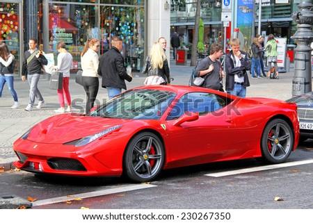 BERLIN, GERMANY - AUGUST 16, 2014: Red supercar Ferrari 458 Italia at the city street. - stock photo