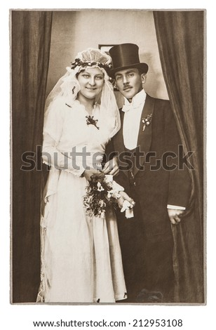 BERLIN, GERMANY - CIRCA 1930: antique wedding photo. portrait of just married couple. nostalgic picture with original scratches and film grain - stock photo