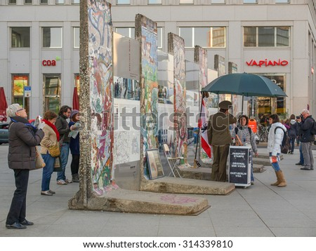 BERLIN, GERMANY - CIRCA APRIL, 2010: Tourists visiting the remains of Berliner Mauer meaning Berlin Wall - stock photo