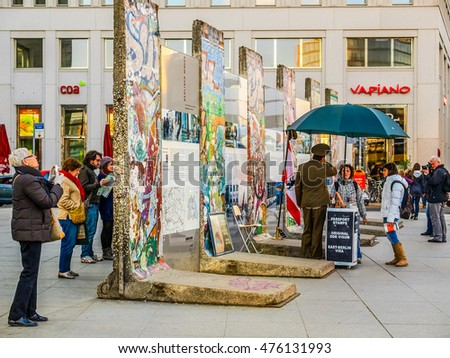 BERLIN, GERMANY - CIRCA APRIL, 2010: Tourists visiting the remains of Berliner Mauer meaning Berlin Wall (HDR)