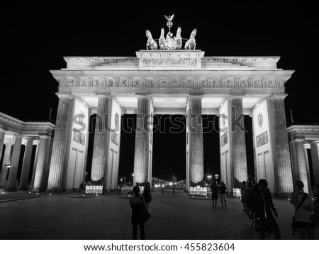 BERLIN, GERMANY - CIRCA JUNE 2016: Tourists at Brandenburger Tor (meaning Brandenburg Gate) at night in black and white