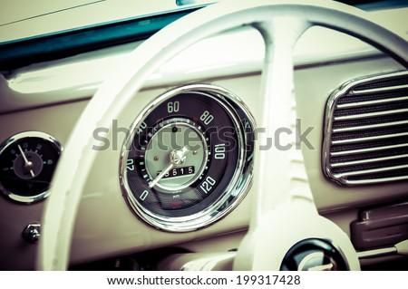 BERLIN, GERMANY -CIRCA SEPTEMBER 2011: Speedometer and steering wheel VW Beetle 1960th - stock photo