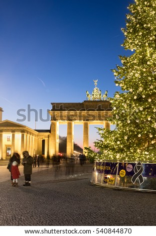 BERLIN, GERMANY - DECEMBER 21, 2016: Panorama of Branderburger Gate, black ribbon sigh on base of Christmas tree. Life in the capital goes back to normal two days after the Christmas market attack.