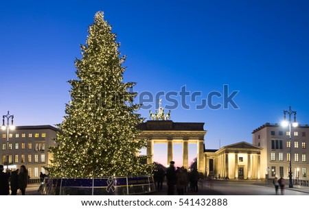 BERLIN, GERMANY - DECEMBER 21, 2016: Panorama of Branderburger Gate with Christmas tree. Life in the capital is going back to normal two days after the terror attack on the Christmas market.