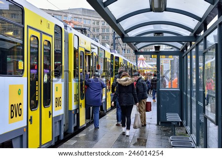 BERLIN, GERMANY-DECEMBER 23, 2014: Tram stopped at Alexanderplatz. In december Alexanderplatz square hosts big Christmas market - stock photo
