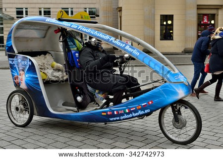 BERLIN, GERMANY-DECEMBER 23, 2014: Velo rickshaw on the street in Berlin