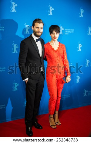 BERLIN, GERMANY - FEBRUARY 11: Actor Jamie Dornan with Amelia Warner, 'Fifty Shades of Grey' premiere. 65th Berlinale International Film Festival at Zoo Palast on February 11, 2015 in Berlin, Germany. - stock photo