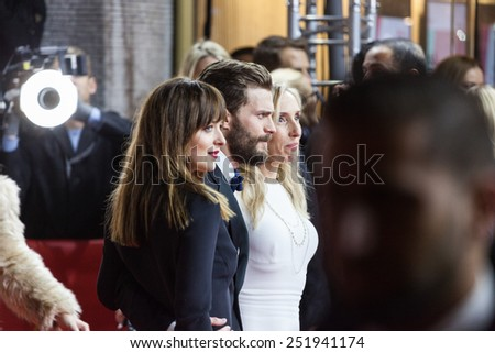 BERLIN, GERMANY - FEBRUARY 11, 2015: Actress Dakota Johnson, actor Jamie Dornan and director Sam Taylor-Johnson attend the 'Fifty Shades of Grey' premiere during the 65th Berlinale  - stock photo