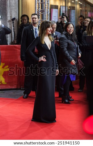 BERLIN, GERMANY - FEBRUARY 11, 2015: Actress Dakota Johnson attends the 'Fifty Shades of Grey' premiere during the 65th Berlinale International Film Festival at Zoo Palast  - stock photo