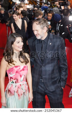 BERLIN, GERMANY - FEBRUARY 09: Alessandra Mastronardi and Anton Corbijn attend the 'Life' premiere during the 65th Berlinale International Film Festival at Zoo Palast on February 9, 2015