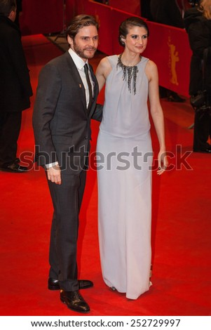 BERLIN, GERMANY - FEBRUARY 14, 2015: Daniel Bruehl and his girlfriend Felicitas Rombold attend the Closing Ceremony of the 65th Berlinale International Film Festival at Berlinale Palace