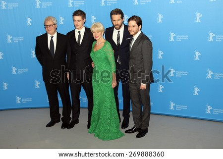 BERLIN, GERMANY - FEBRUARY 09: Daniel Bruehl, Helen Mirren, Max Irons attend the 'Woman in Gold' photocall during the 65th Berlinale Festival at  Hyatt Hotel on February 9, 2015 in Berlin, Germany. - stock photo