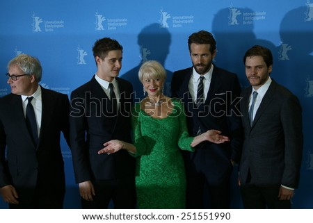 BERLIN, GERMANY - FEBRUARY 09: Helen Mirren, Ryan Reynolds, Daniel Bruehl attend the 'Woman in Gold' photocall during the 65th Berlinale Festival at Hyatt Hotel on February 9, 2015 in Berlin, Germany. - stock photo
