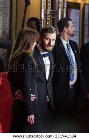 BERLIN, GERMANY - FEBRUARY 11: Jamie Dornan and Dakota Johnson attend the 'Fifty Shades of Grey' premiere during the 65th Berlinale International Film Festival at Zoo Palast on February 11, 2015 - stock photo