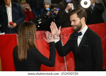 BERLIN, GERMANY - FEBRUARY 11: Jamie Dornan, Dakota Johnson and attend the 'Fifty Shades of Grey' premiere during the 65th Berlinale  Festival at Zoo Palast on February 11, 2015 in Berlin, Germany. - stock photo