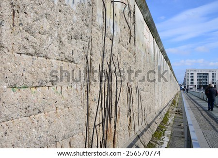 BERLIN, GERMANY - FEBRUARY 24, 2015: Part of a remaining section of the Berlin Wall, at the the Topography of Terror museum on Niederkirchnerstrasse, formerly Prinz-Albrecht-Strasse, Berlin, Germany.