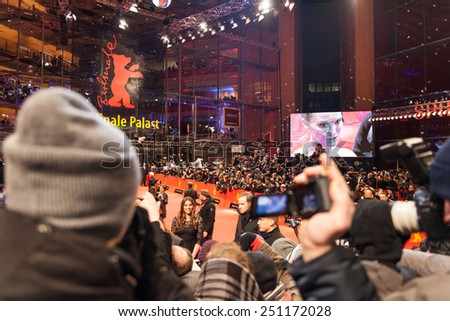 BERLIN, GERMANY - FEBRUARY 08: People  watching the red carpet walk during 65th Berlinale International Film Festival at Berlinale Palace on February 8, 2015 in Berlin, Germany. - stock photo
