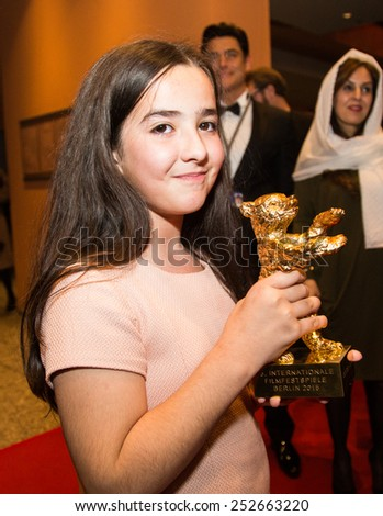 BERLIN, GERMANY - FEBRUARY 14: Solmaz Panahi, Niece of Jafar Panahi with golden bear for 'Taxi'. Closing Ceremony. 65th Berlinale at Berlinale Palace on February 14, 2015 in Berlin, Germany. - stock photo