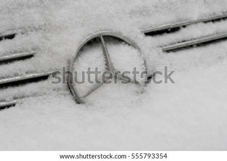 Berlin, Germany - January 11, 2016: frozen Mercedes logo. Mercedes-Benz is automobile manufacturer and division of German company Daimler AG. The brand is known for luxury vehicles, coaches and trucks