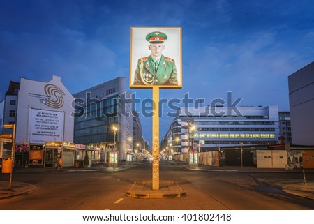 BERLIN, GERMANY - JANUARY 18, 2014. Night View of Checkpoint Charlie, during the Cold War it was a crossing point between East and West Berlin.  - stock photo