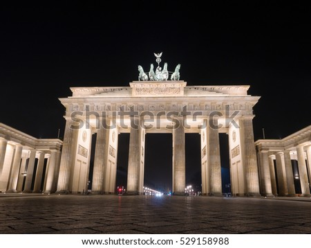 BERLIN,GERMANY - JANUARY 3, 2016: Tourists visit the  Brandenburger Tor, one of the best-known landmarks and national symbols of Germany at night