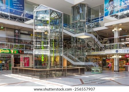BERLIN, GERMANY - JUL 21: Customers in a Shopping-centre with a water clockwork from 13 meters high on July 21, 2013 in the Europa Centre of Berlin, Germany