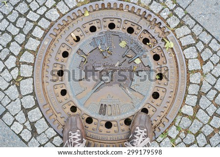 BERLIN, GERMANY - JULY 08: Berlin manhole cover design depicting TC tower and other landmarks. July 08, 2015 in Berlin. - stock photo