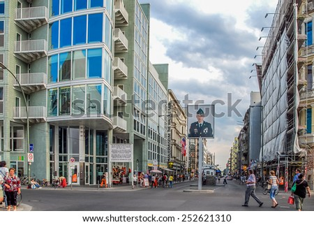 BERLIN, GERMANY - July 26, 2008 CHECKPOINT CHARLIE Streetview  Checkpoint Charlie is the most famous crossing point between East and West Germany during the cold war. - stock photo