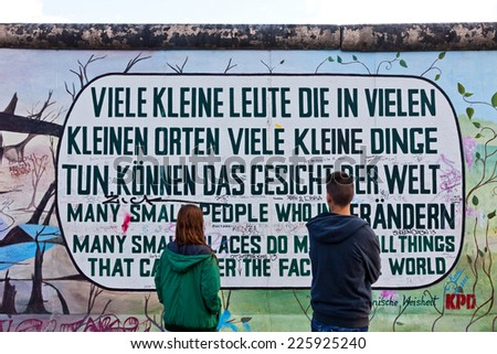 BERLIN, GERMANY - JULY 2, 2014: Fragment of East Side Gallery in Berlin. It's a 1.3 km long part of original Berlin Wall which collapsed in 1989 and now is the largest world graffiti gallery - stock photo