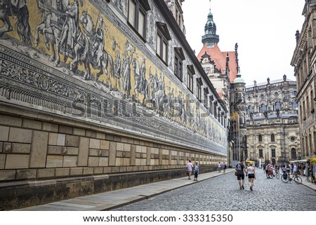 Berlin, Germany - July 05, 2015: Furstenzug (Procession of Princes, 1871-1876, 102 meter, 93 people) is a giant mural decorates the wall. Dresden, Germany