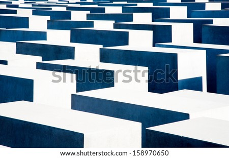 BERLIN, GERMANY - JULY 22, 2013:Holocaust Memorial  in the center of Berlin to remember the Jewish victims of the Holocaust, Germany; July 22, 2013   - stock photo