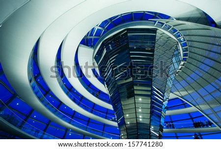 BERLIN, GERMANY - JULY 21, 2013:Inside the glass dome of the Reichstag in Berlin, Germany; July 21, 2013   - stock photo